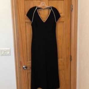 Black midi dress with cream piping accents